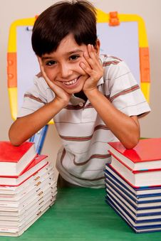 Free Cute Young Boy Resting On Books Stock Photos - 15913633