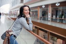 Free Cute Brunette Over Mall Background Stock Image - 15916981