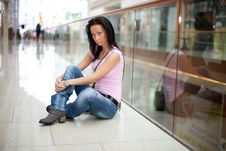 Free Girl Is Sitting In The Shopping Mall Royalty Free Stock Image - 15917026
