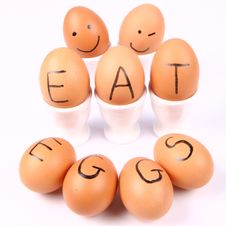 Free Eggs With An Inscription EAT EGGS Royalty Free Stock Images - 15917239