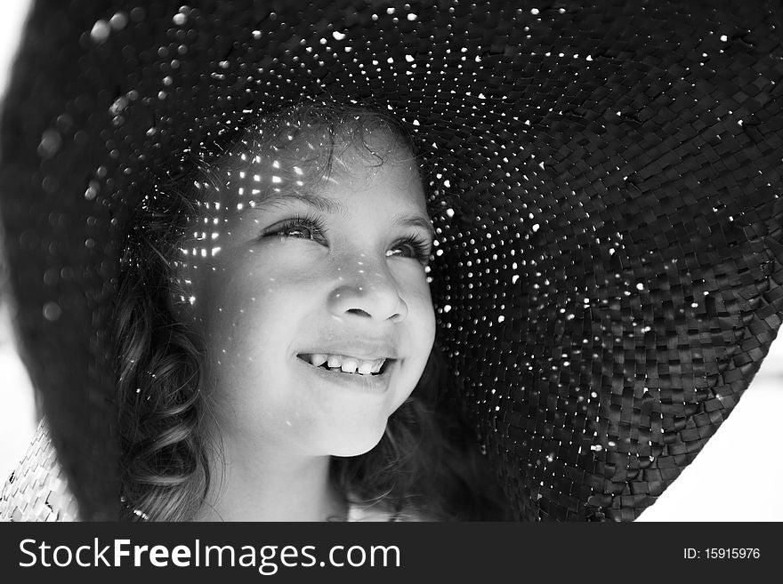 Cute girl in a wide hat