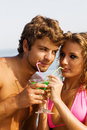 Free Young Couple With Cocktails On The Seaside Royalty Free Stock Photo - 15924325