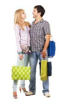 Free Beautiful Young Couple With Shopping Bags Royalty Free Stock Photos - 15924238