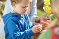 Free Mother And Children Decorating Easter Eggs Royalty Free Stock Images - 15936039