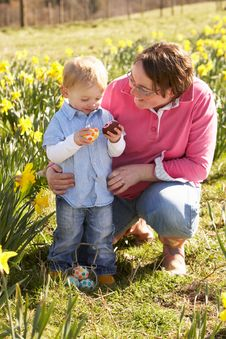 Mother And Son On Easter Egg Hunt Stock Image