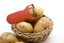 Raw Potatoes With Knife Royalty Free Stock Photo