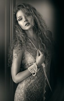Beautiful Woman With Pearl Beads. Royalty Free Stock Images