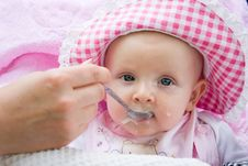 Free Baby Is Fed From A Spoon Royalty Free Stock Photos - 15937758