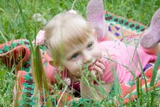 Little Girl Lies On A Grass Stock Images