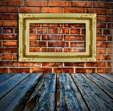Free Gold Picture Frame On Brick Wall And Wood Floor Royalty Free Stock Photo - 15939665