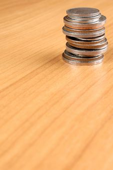 Column Of Coins On Wooden Table Royalty Free Stock Photography