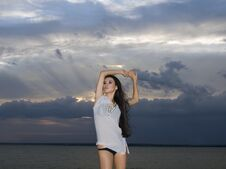 Free Brunette Woman Over Dusk Sky At Sunset Royalty Free Stock Images - 15943539
