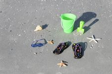 Free Children S Sandals And Playthings Stock Photo - 15943610