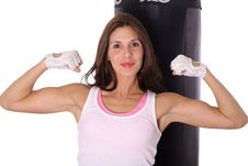 Free Happy Fitness Girl Flexing In Front Of Punching Ba Stock Image - 15943701