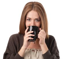 Free Young Woman Sipping From A Cup Royalty Free Stock Photos - 15943928
