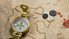 Free Compass And Coins On A Map Royalty Free Stock Images - 15945389