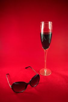 Free Wineglass With Red Wine And Sunglasses Over Red Royalty Free Stock Images - 15945589