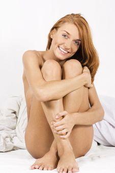 Sexy Naked Girl Sitting On Bed Stock Image