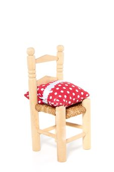 Wooden Chair With A Dotted Pillow Royalty Free Stock Images