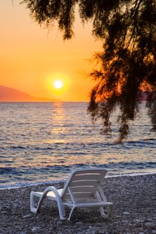 Free Chair On Beach At Sunset Royalty Free Stock Photos - 15951178