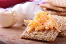 Wheat Crackers With Grated Cheese. Royalty Free Stock Images