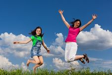 Mother And Daughter Jumping Royalty Free Stock Photos