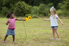 Little Girls With Flowers Royalty Free Stock Photography