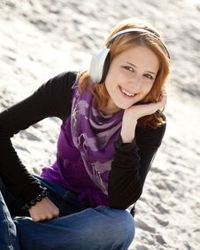 Free Portrait Of Red-haired Girl With Headphone Stock Photography - 15968892