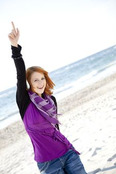 Free Red-haired Girl With Headphone On The Beach. Royalty Free Stock Photos - 15968908