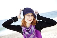 Free Red-haired Girl With Headphone On The Beach. Royalty Free Stock Photo - 15968945