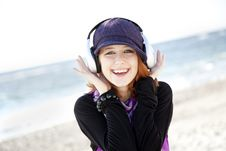 Free Red-haired Girl With Headphone On The Beach. Royalty Free Stock Photography - 15968947