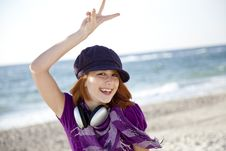 Free Red-haired Girl With Headphone On The Beach. Stock Photography - 15969172