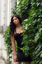 Free Beautiful Brunette Woman In A Black Dress Stock Photography - 15974002