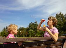 Free Mother And Son Blowing Soap Bubbles Stock Photography - 15970242