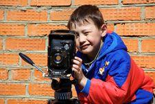Kid Making A Shot With Retro Camera Stock Photos