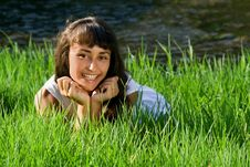 Young Girl On The Grass Near The River Stock Images