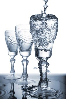 Flowing Water In Glass Stock Photography
