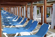 Row Of Blue Deck Chairs Stock Photos