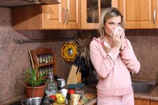 Free Woman With Hot Drink In The Kitchen Stock Images - 15975554