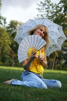 Free A Girl With An Umbrella And A Fan Royalty Free Stock Photos - 15976598