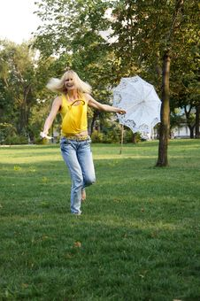 A Girl With An Umbrella And A Fan Royalty Free Stock Photos