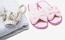 Free Slippers, Grey Folded Towel And Metr Stock Image - 15978341