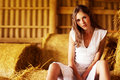 Free A Beautiful Young Woman Is Resting On The Hay Royalty Free Stock Image - 15980686