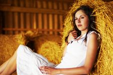 Free A Young Woman Is Resting On The Hay Stock Image - 15980431