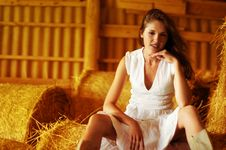 Free A Young And Cute Girl Is Sitting On A Pile Of Hay Stock Image - 15980761
