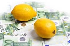 Lemons Lying On 100 Euro Banknotes Royalty Free Stock Image
