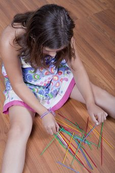 Free Girl Playing Mikado On The Floor Stock Image - 15981451