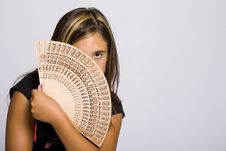 Girl With Fan In Her Hand Royalty Free Stock Photo