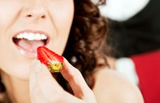 Free Woman Eating Strawberry Royalty Free Stock Image - 15986336