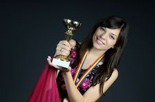 Free Teen Showing Golden Cup Royalty Free Stock Images - 15987099